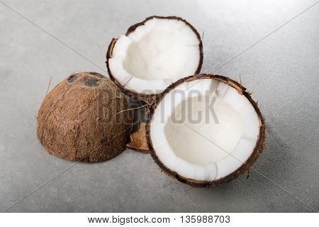 Coconuts shells on grey background