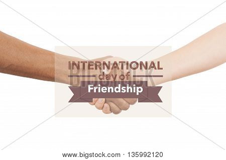 International day of friendship banner. Shaking hands