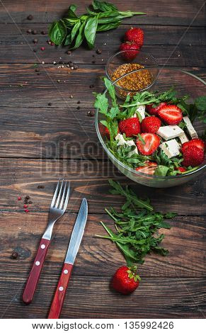 Salad of lettuce, arugula, strawberries feta cheese