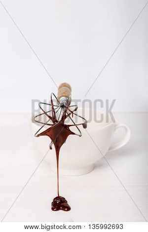 Molten chocolate on a whisk