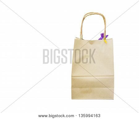 Blank brown paper bag isolated on white background.