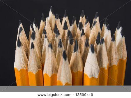 pencils over black