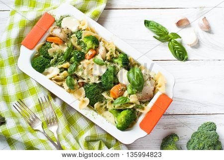 Casserole pasta with fish and broccoli with cream sauce and cheese with garlic. Summer dish.