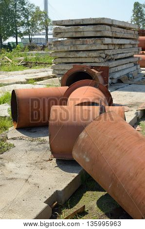 Fragments of building material.Iron pipes concrete slabs and more.