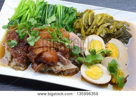 The pork leg stewed in the gravy. A favorite fast food menu of Thai food.
