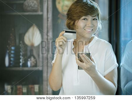 asian woman happiness smiling face holding credit in hand for shopping on line people modern lifestyle