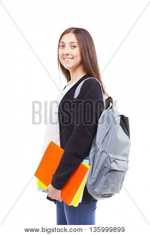 Cute attractive student girl holding colorful notebooks, isolated on white background