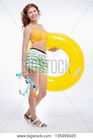 woman with swimming accessories on white background