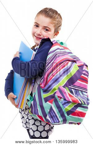 Cute preschool student girl holding notebooks and backpack on white background