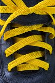stock photo of grommets  - Close up of old yellow shoelace and details - JPG
