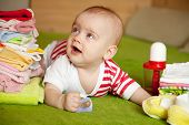 image of babygro  - Happy baby girl with heap of baby - JPG