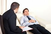 stock photo of hypnotizing  - Psychiatrist man talking with hypnotized male patient - JPG