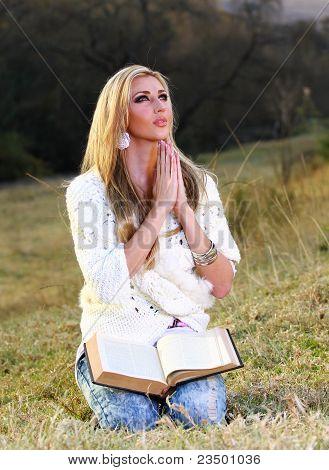 Lady Praying In Park