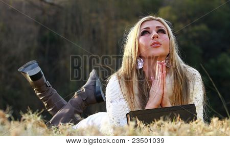 Blonde Lady Praying Lying On Her Stomach