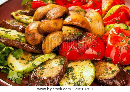 Baked vegetables: potato, zucchini, eggplant on plate. Vegetarian food