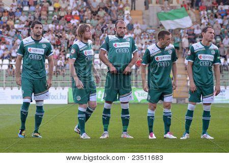 KAPOSVAR, HUNGARY - SEPTEMBER 10: Gyor players before a Hungarian National Championship soccer game - Kaposvar (white) vs Gyor (green) on September 10, 2011 in Kaposvar, Hungary.