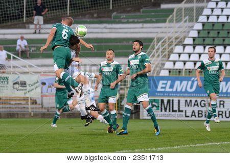 KAPOSVAR, HUNGARY - SEPTEMBER 10: Zoltan Feher (green 6) in action at a Hungarian National Championship soccer game - Kaposvar (white) vs Gyor (green) on September 10, 2011 in Kaposvar, Hungary.
