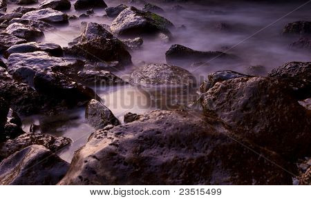 Peaceful Stones At The Sea Shore Background
