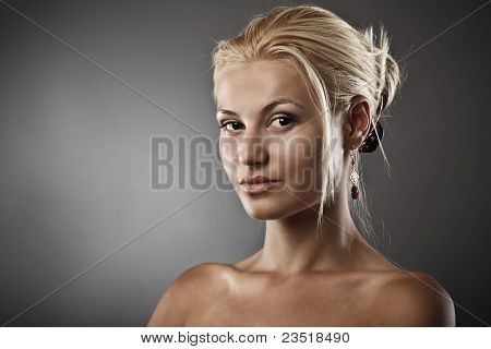Beautiful Woman On Gray Background