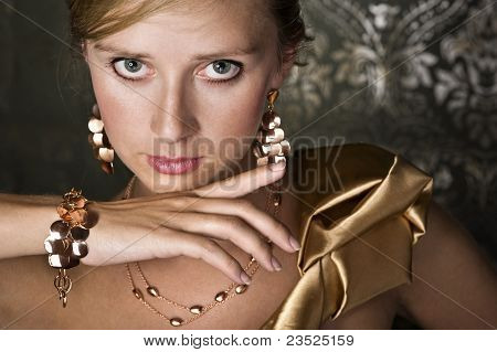 Elegant Woman And Gold Jewelry