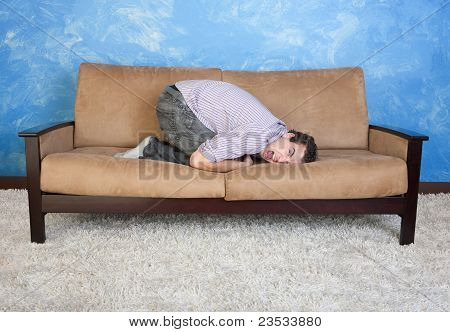 Frustrated Man On Sofa