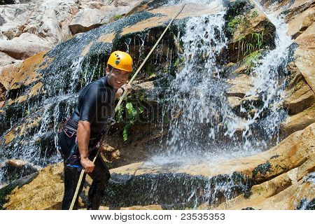Men Descending Waterfall