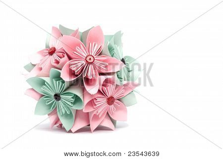 Colored paper flower on a white background