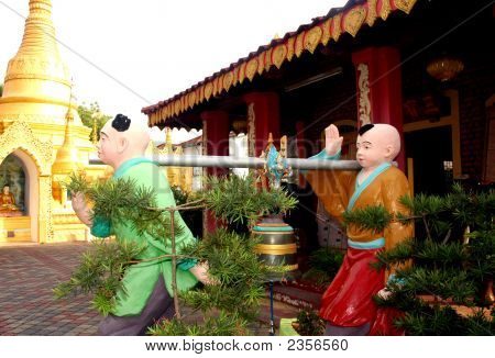 2 Males Monk Statues At A Temple In Malaysia