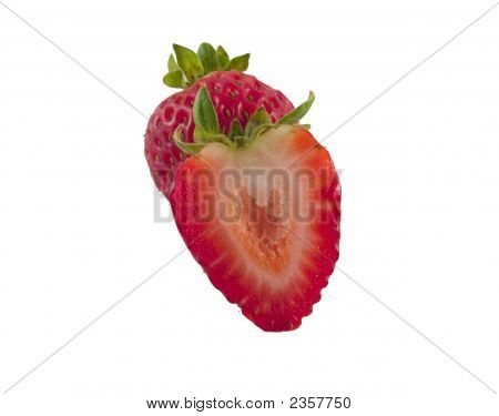 A Whole Strawberry And Half Isolated On White