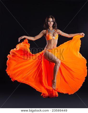beauty dancer posing in orange veil - arabia style