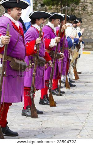 BRIHUEGA, SPAIN - SEPTEMBER 4: Troop of soldiers in training during the re-enactment of the War of Succession. September 4, 2010 in Brihuega, Spain