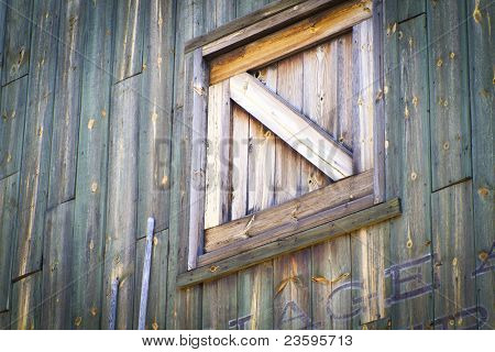 window and wall of a vintage wood house, western