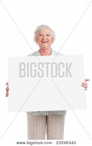 Happy smiling senior woman holding blank placard to write it on your own text, isolated on white background