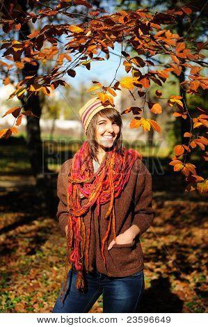Smiling happy girl portrait, autumn outdoor.