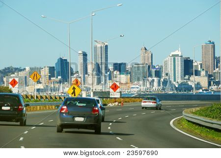 high way traffic with Auckland city background