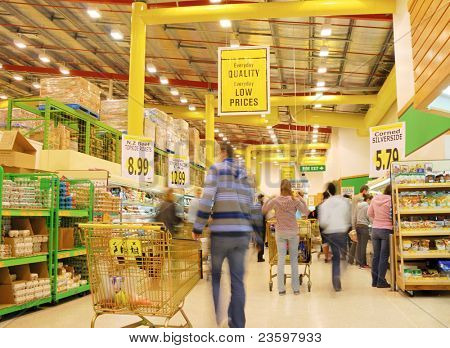 people's motion in busy supermarket