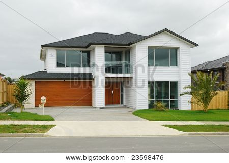 brand new show home with landscaped front yard