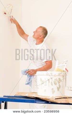 Home Decorating Mature Man With Paint Roller