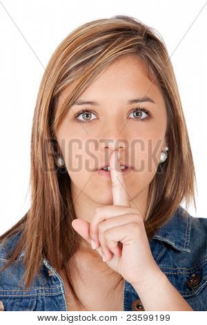 Girl making a gesture asking for silence - isolated over a white background