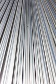 Corrugated Grey Shiny Metal With Rivets. New Roof Of Industrial Building. poster