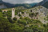 Ancient Stone Ruins And Clock Tower At Old Bar Town On The Cloudy Mountains Landscape, Montenegro. S poster