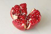 Постер, плакат: Big Ripe Red Granet Or Garnet Fruits Of Red Ripe Pomegranate On The White Background Vegetarian Co