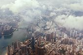 Aerial View Through The Clouds To A Large Metropolis City Of Hong Kong. poster