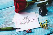 a red rose, an ink bottle, a nib pen and the text t estimo and Felic Sant Jordi, I love you and happ poster