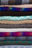 Colorful Traditional Peruvian Fabrics On The Market In Cusco, Peru poster