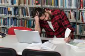 Unhappy Student With Too Much To Study poster