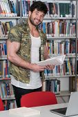 Bodybuilder Student Studying At College poster