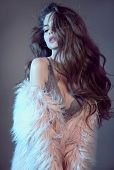 Wavy Hairstyle. High Fashion Sensuality Portrait Of Gorgeous Sexy Brunette Woman With Long Healthy H poster