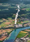 Cooling Tower Near The River. Vapour Goes Out From Cooling Tower. An Aerial View From Plane. Portrai poster