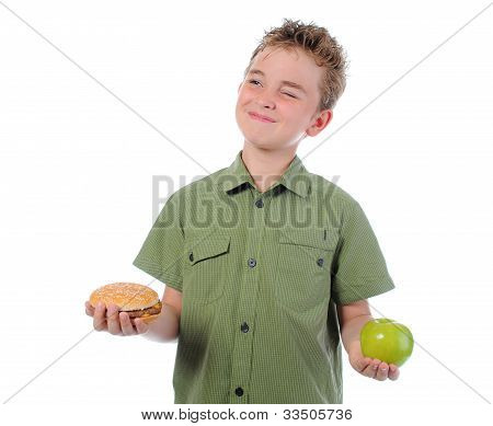 Little boy eating a hamburger